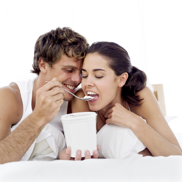 portrait of a young couple eating ice-cream from the ice-cream tub